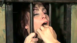 Chick in the cage licks tootsies of..
