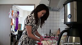 Japan housewife Maki Hojo gives a..