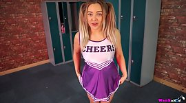 Pigtailed cheerleader Beth gives a..